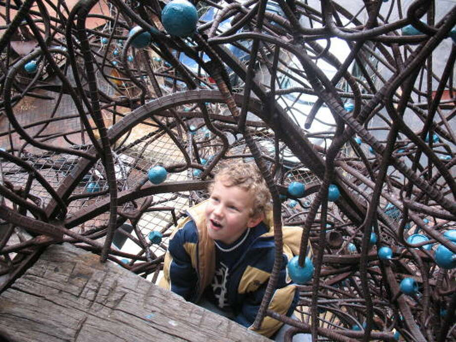 Daniel Jones, 7, is enthralled with the multiplicity of staircases climbing through The Monstrosity at the City Museum. Photo: Tracy Barnett, Chronicle