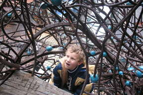 Daniel Jones, 7, is enthralled with the multiplicity of staircases climbing through The Monstrosity at the City Museum.