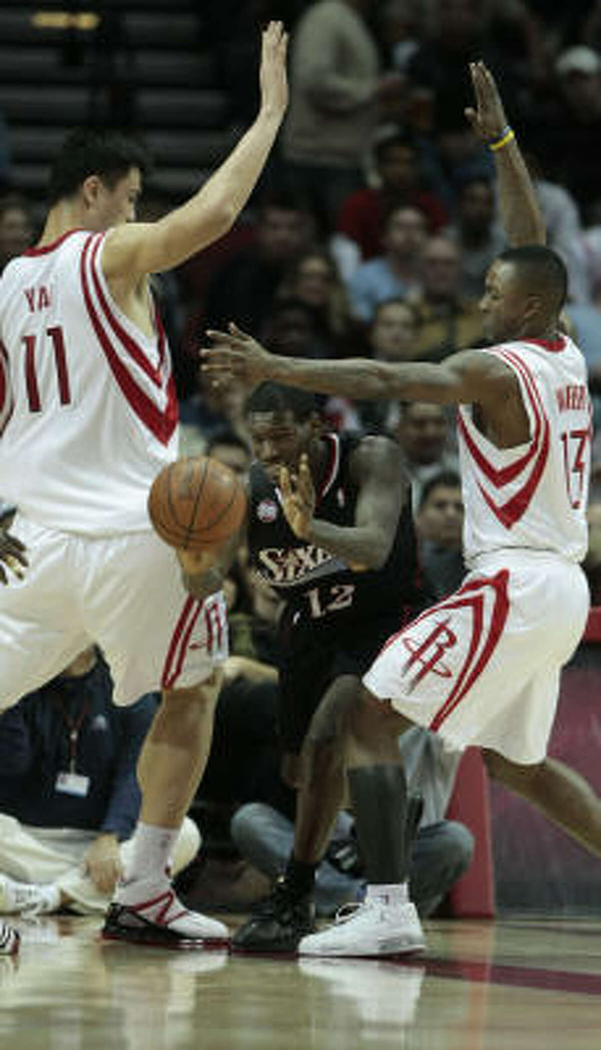 Yao Ming, from left, defends against a pass by 76ers guard Royal Ivey with support from Von Wafer in the second half.