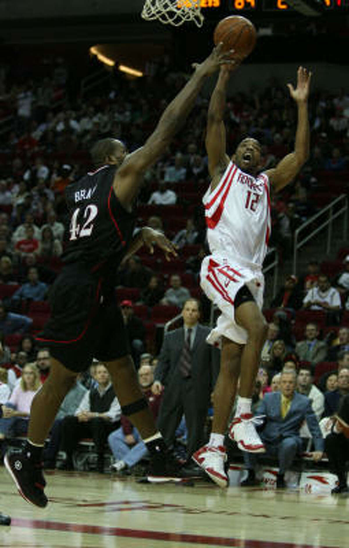76ers forward Elton Brand, left, attempts to block a shot Rafer Alston during the second half.