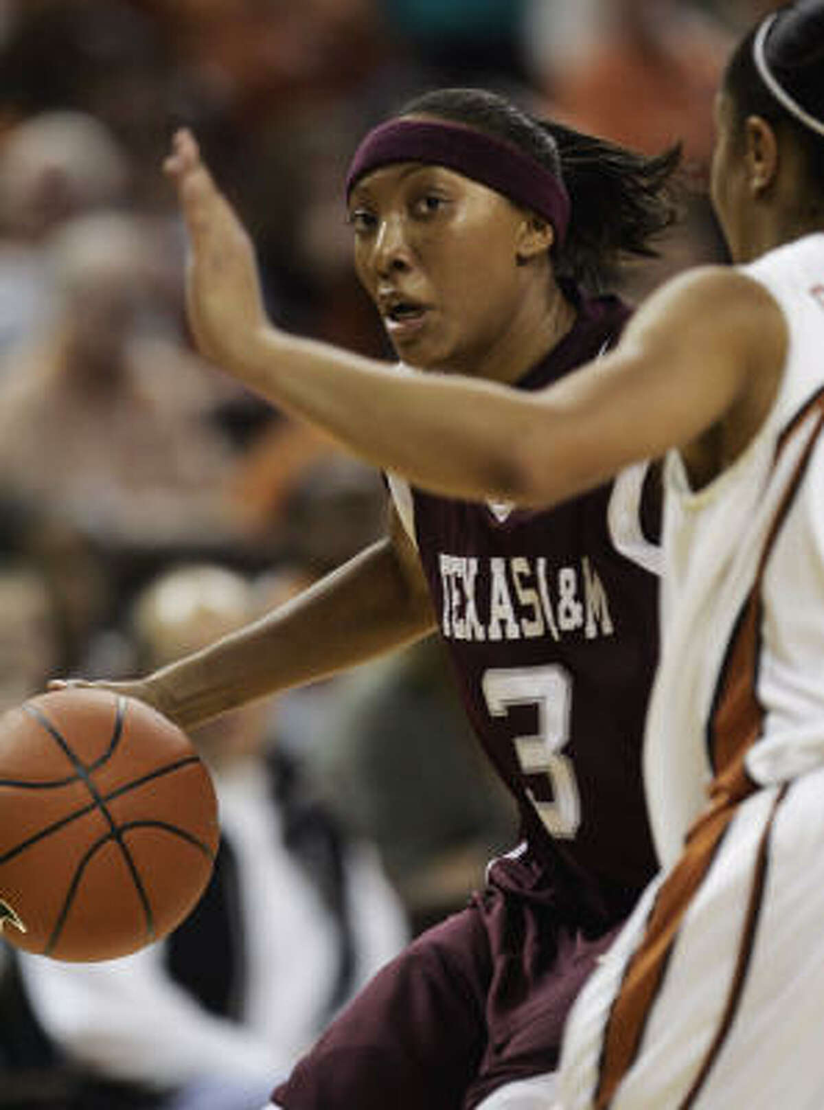 Texas A&M guard Takia Starks, left, scored 26 points in Wednesday's 68-54 win over Texas.