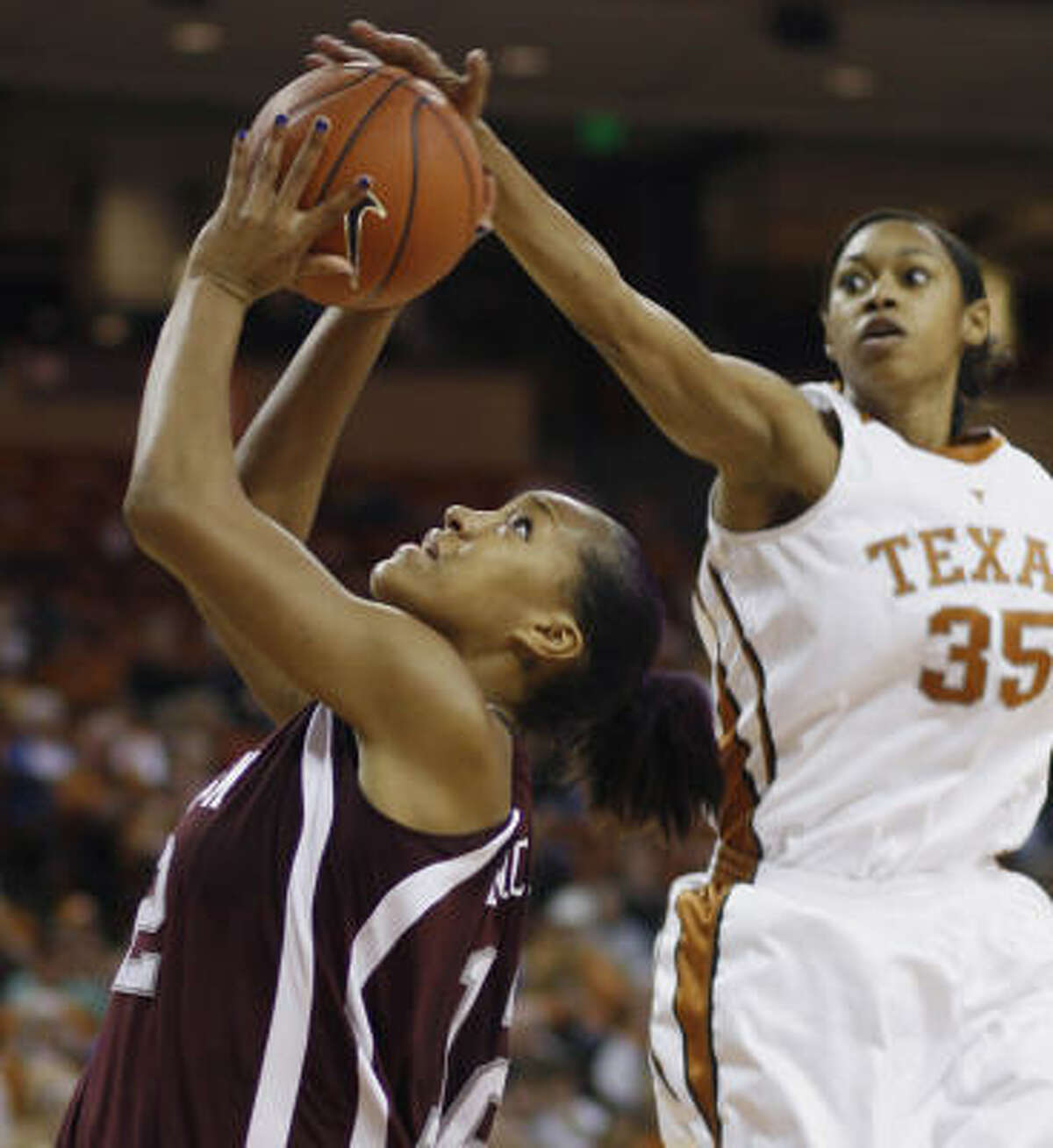 Texas forward Ashley Lindsey, right, blocks a shot from Texas A&M center La Toya Micheaux during the second half. Lindsey finished with three blocks and is now second in the Texas record book for career blocks.