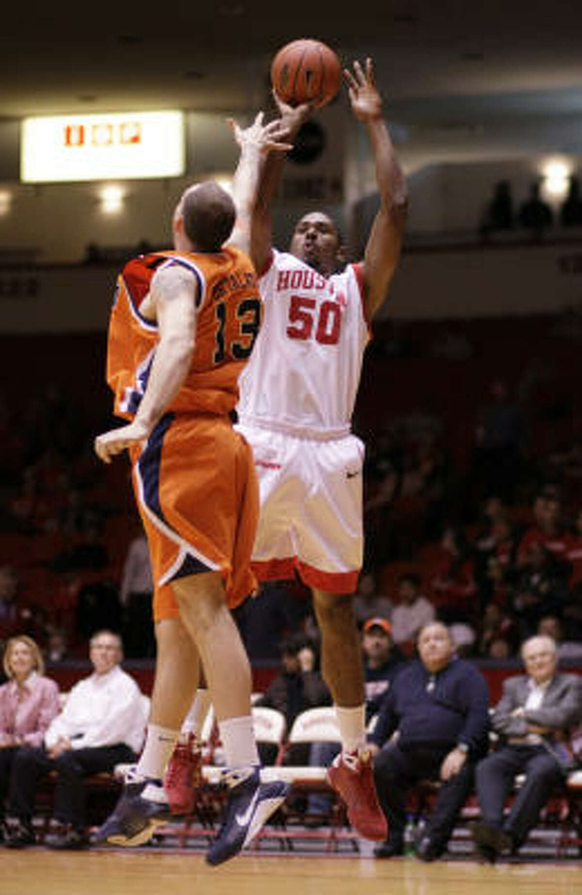 UH center Marcus Cousin shoots over UTEP's Wayen Portalatin during the first half of Wednesday's game. UTEP won 62-55.