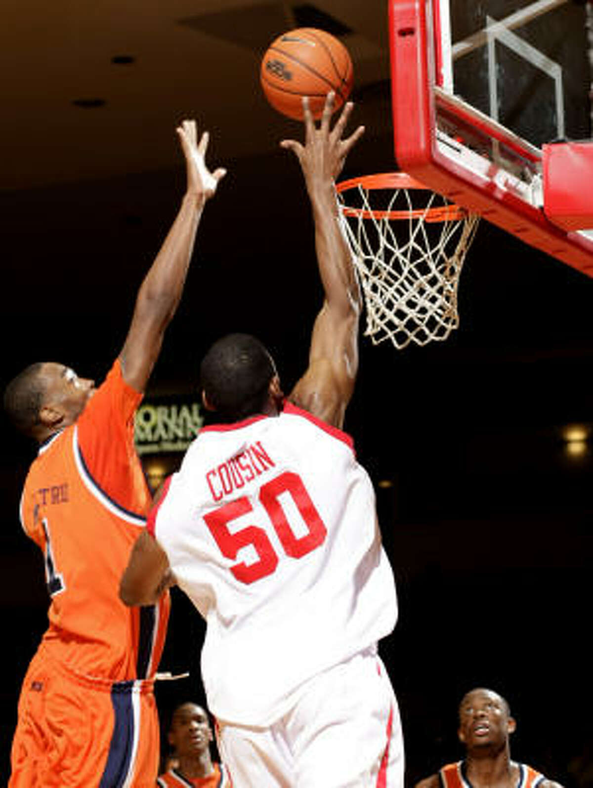 Houston's Marcus Cousin puts a shot up over UTEP's Arnett Moultrie during the second half.