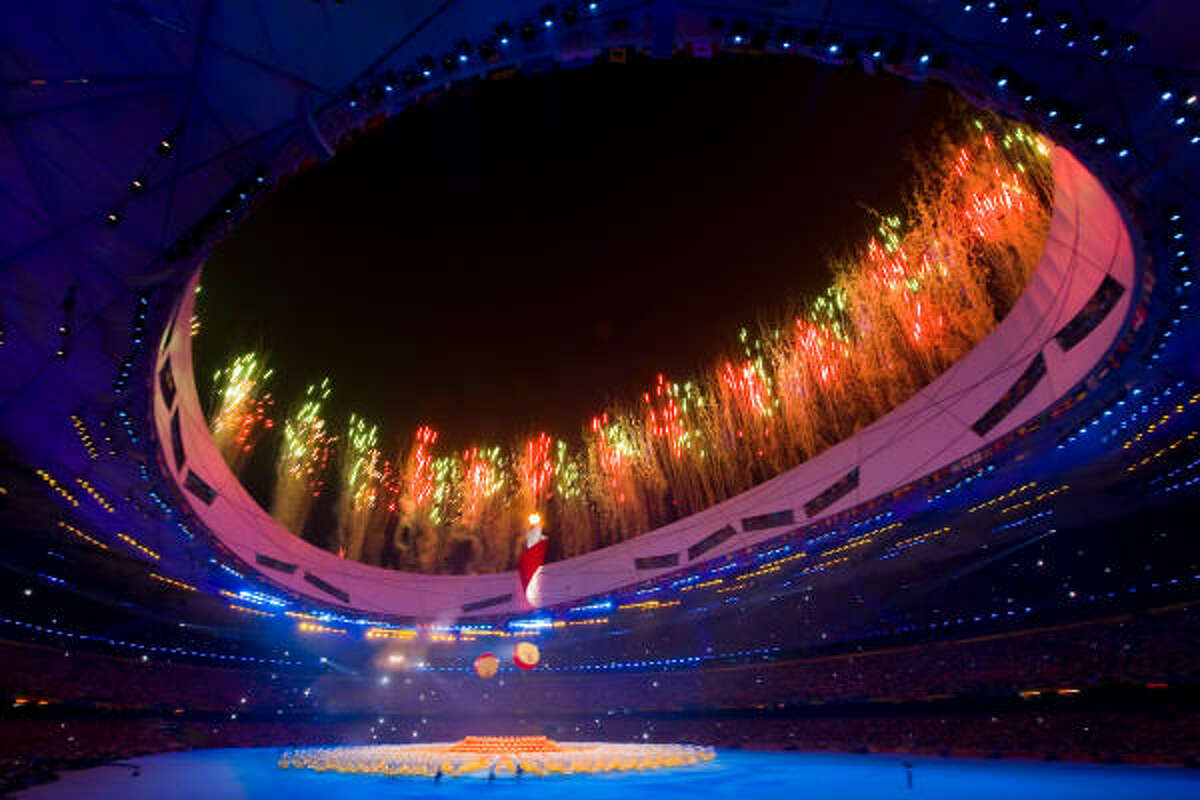 Fireworks explode over the National Stadium, also known as the Bird's Nest, during closing ceremonies for the 2008 Summer Olympic Games, Sunday, Aug. 24, 2008, in Beijing.