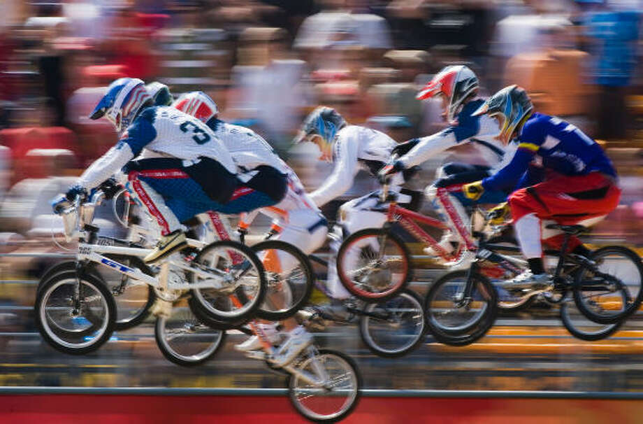 Mike Day of the United States leads a semifinal race ahead of fellow Americans Donny Robinson  and Kyle Bennett during  BMX cycling at the 2008 Summer Olympic Games. Photo: Smiley N. Pool, Chronicle