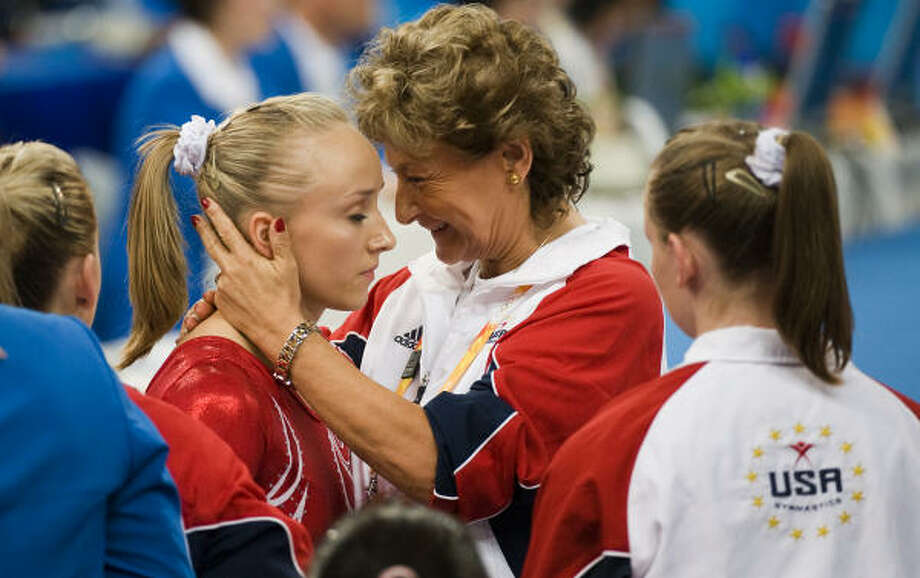 "Nastia Liukin (left) and the U.S women's gymnastics squad nabbed silver in the team competition. ""We're just as good as China,"" said national team coordinator Martha Karolyi. ""We made mistakes. They did not."" Photo: Smiley N. Pool, Chronicle"