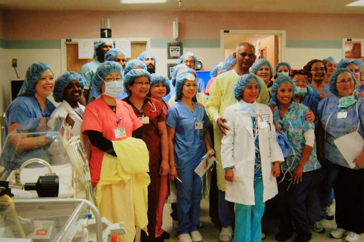 In this handout photo provided by Kaiser Permanente Bellflower Medical Center, the nursing staff poses for a photo following the Jan. 26 delivery of octuplets in Bellflower, Calif.
