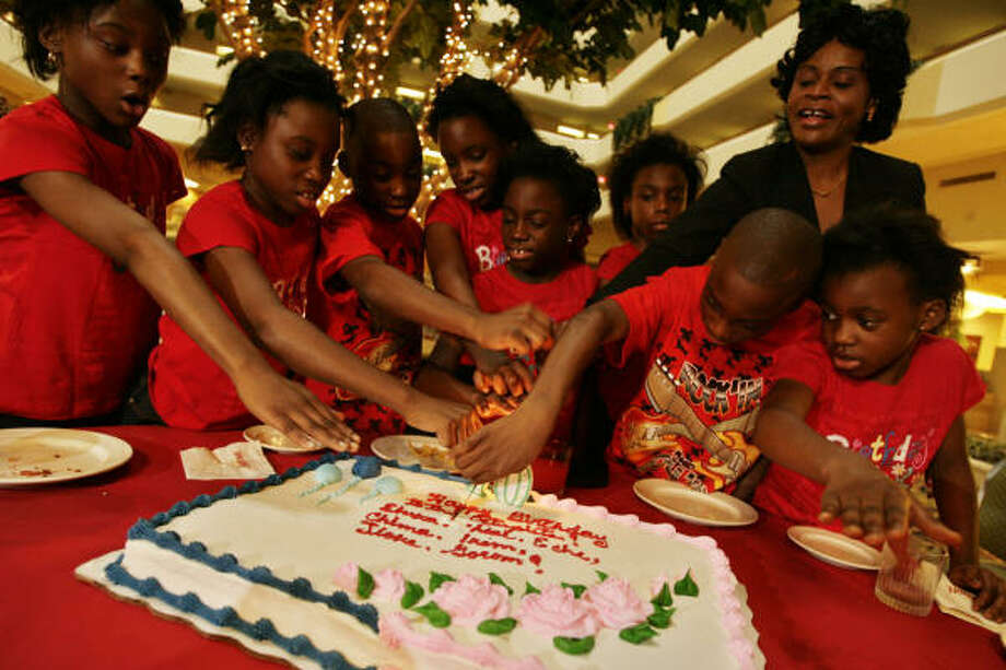 From left, Ebuka, Echerem, Jioke, Chima, Gorom, Chidi, and Ikem, the surviving octuplets born to Nkem Chukwu, right, and husband Ikye Louis Udobi, celebrate their 10th birthday Dec. 20, 2008 in Houston. At right is little sister Favor, 6. Photo: Eric Kayne, Houston Chronicle