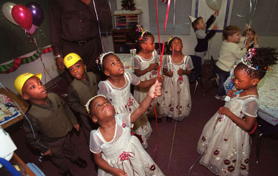 The seven surviving Chukwu octuplets Chidi, center, and from left to right, Ikem, Jioke, Ebuka,  Echerem, Gorom and Chima play with balloons as they celebrate their fourth brithday in Houston in 2002. Photo: Carlos Antonio Rios, Houston Chronicle