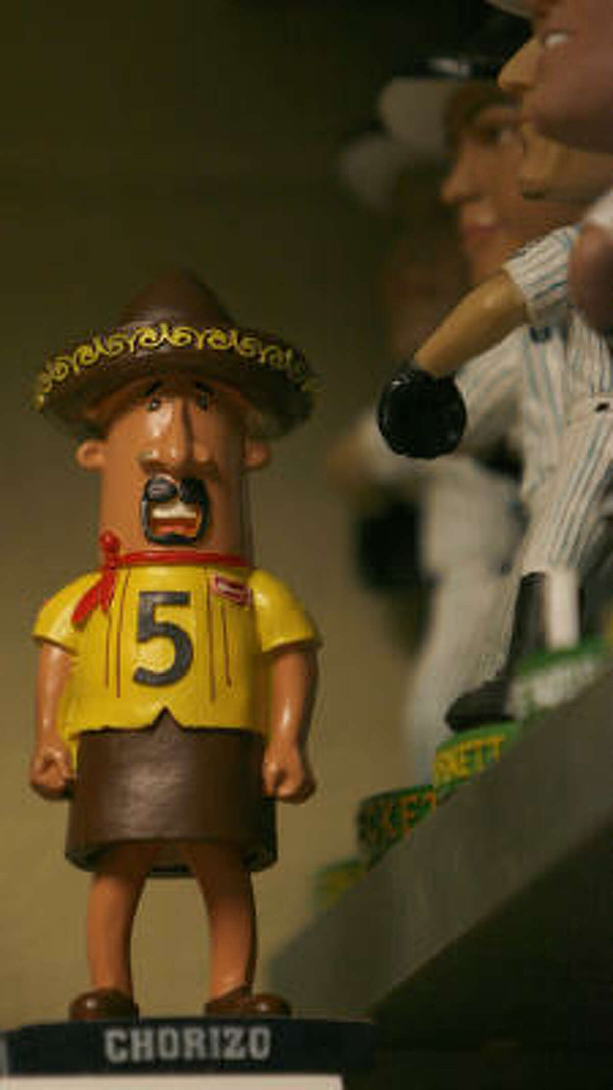 CHORIZO, SAUSAGE RACER OF THE MILWAUKEE BREWERSIt wouldn't creep you out if ... : Like the garlic head, you put it in your kitchen.