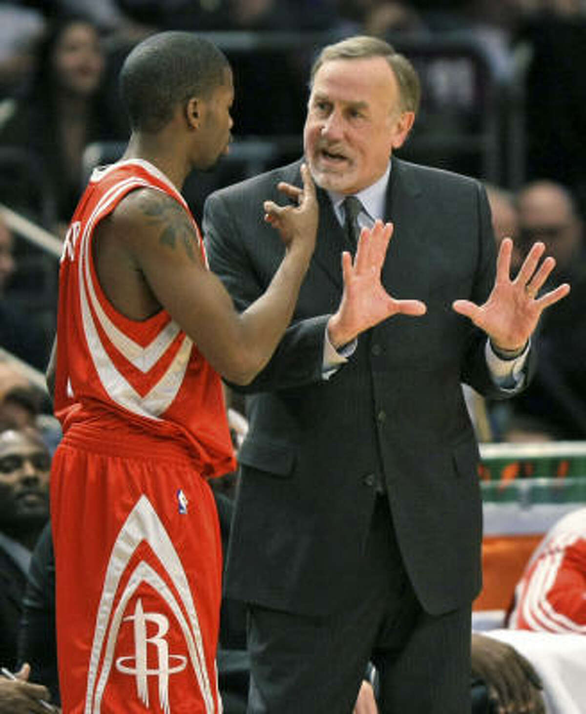 Rockets coach Rick Adelman gestures as he talks to guard Aaron Brooks in the fourth quarter.