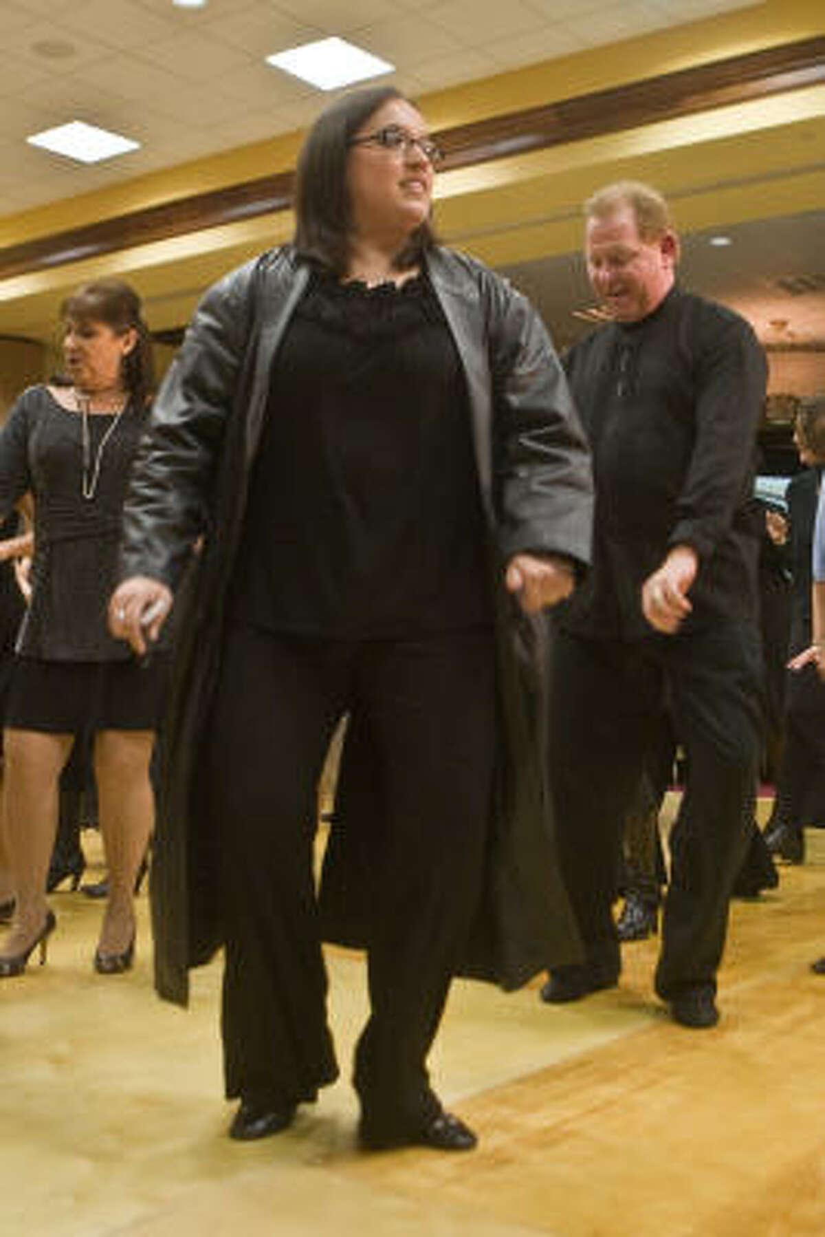 DANCING WITH THE PRINCIPALS: Tiffany Espinoza of Pasadena was one of dozens of guests who joined in on a warmup dance at Pasadena ISD's