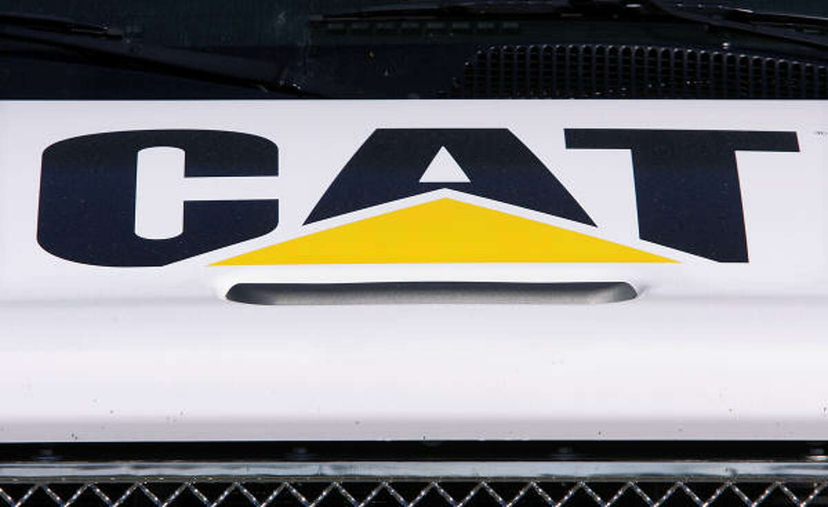 Construction equipment titan Caterpillar, which is building a new plant in the Seguin area, said it would cut 20,000 jobs this year after reporting fourth-quarter profit fell by almost a third.