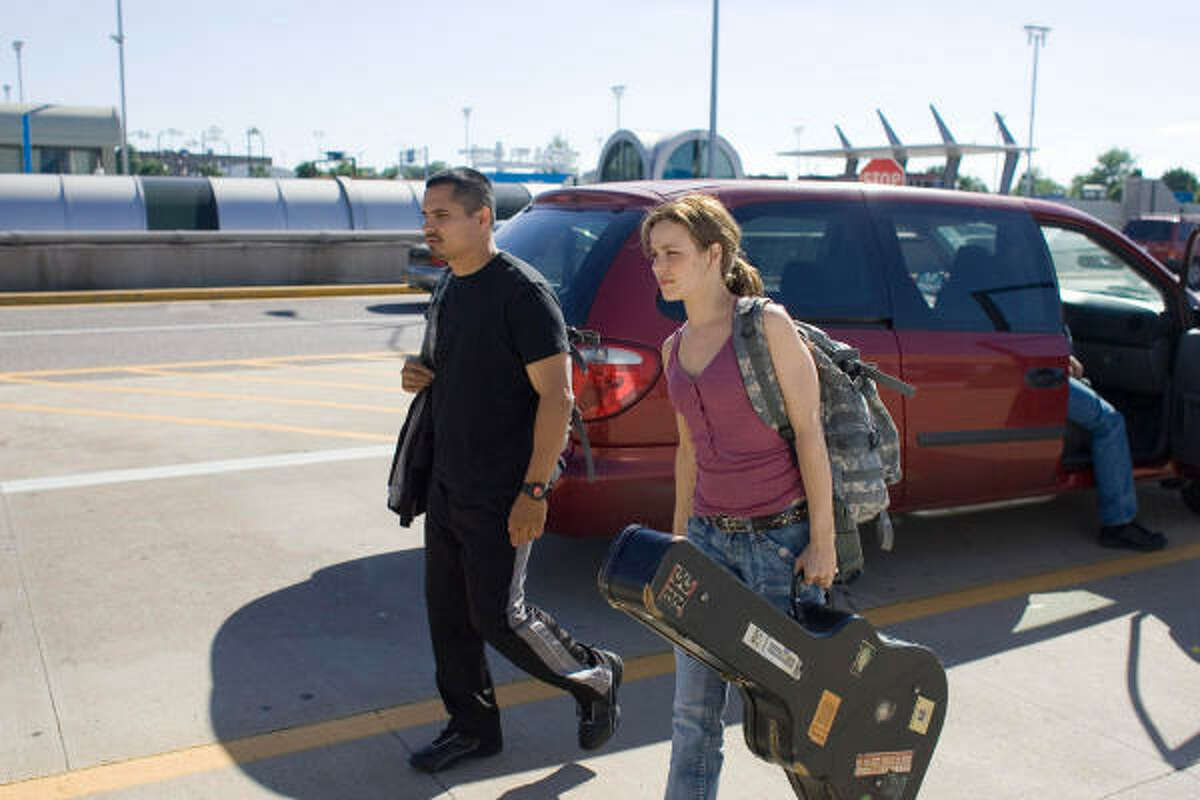 Michael Pena, left, and Rachel McAdams star in The Lucky Ones.