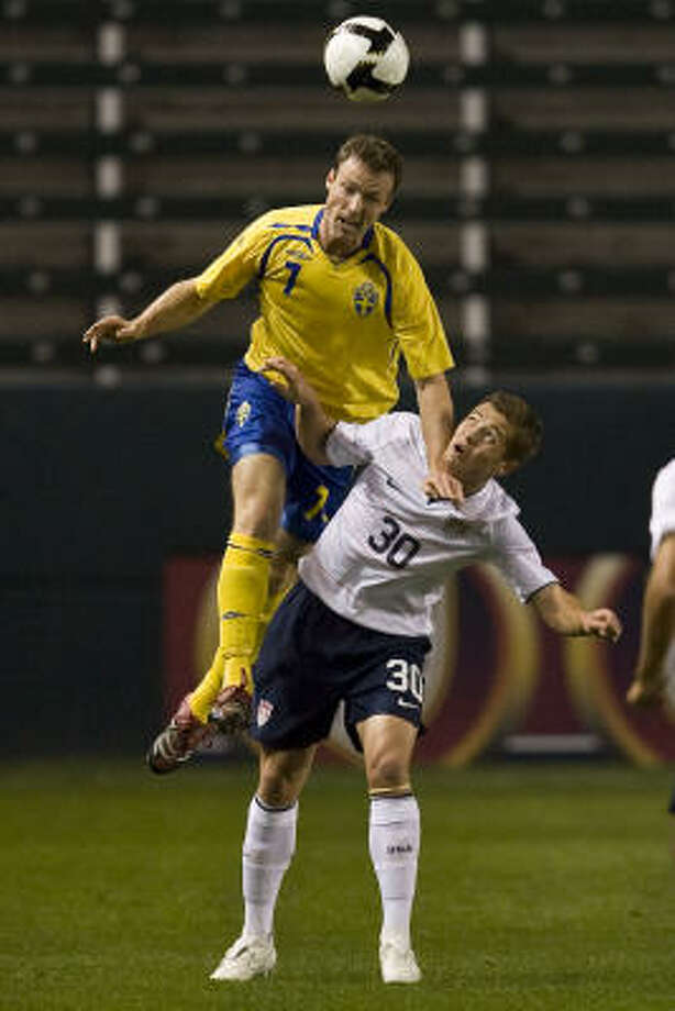 Sweden defender Markus Jonsson, top, goes up for the ball over United States midfielder Robbie Rogers in the first period. Photo: Mark Avery, AP