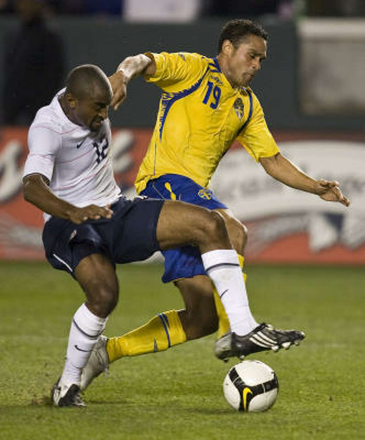 Sweden forward Daniel Nannskog and United States defender Marvell Wynne battle for the ball.