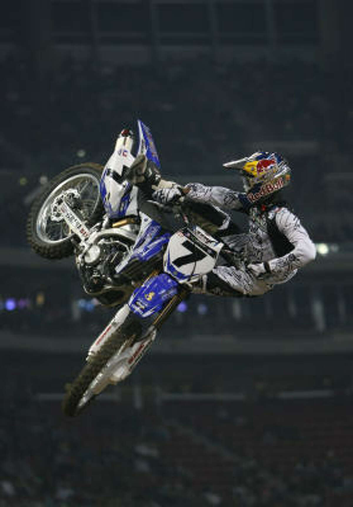 James M. Stewart wins the second heat of the AMA Supercross class at the 2009 Houston Supercross.