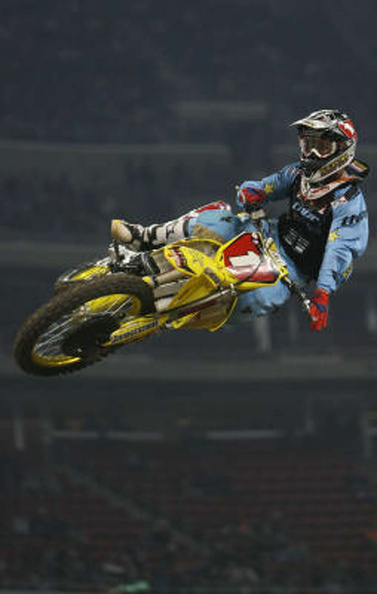 Chad Reed wins the first heat of the AMA Supercross at Reliant Stadium.