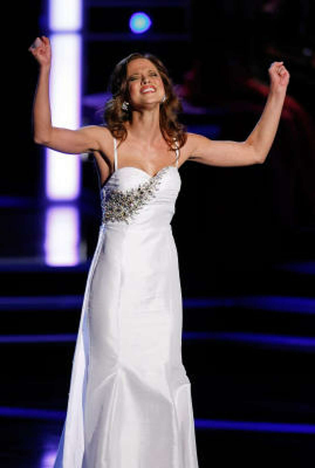 Stam didn't let a throat infection and laryngitis stop her from belting out a song during the talent portion.