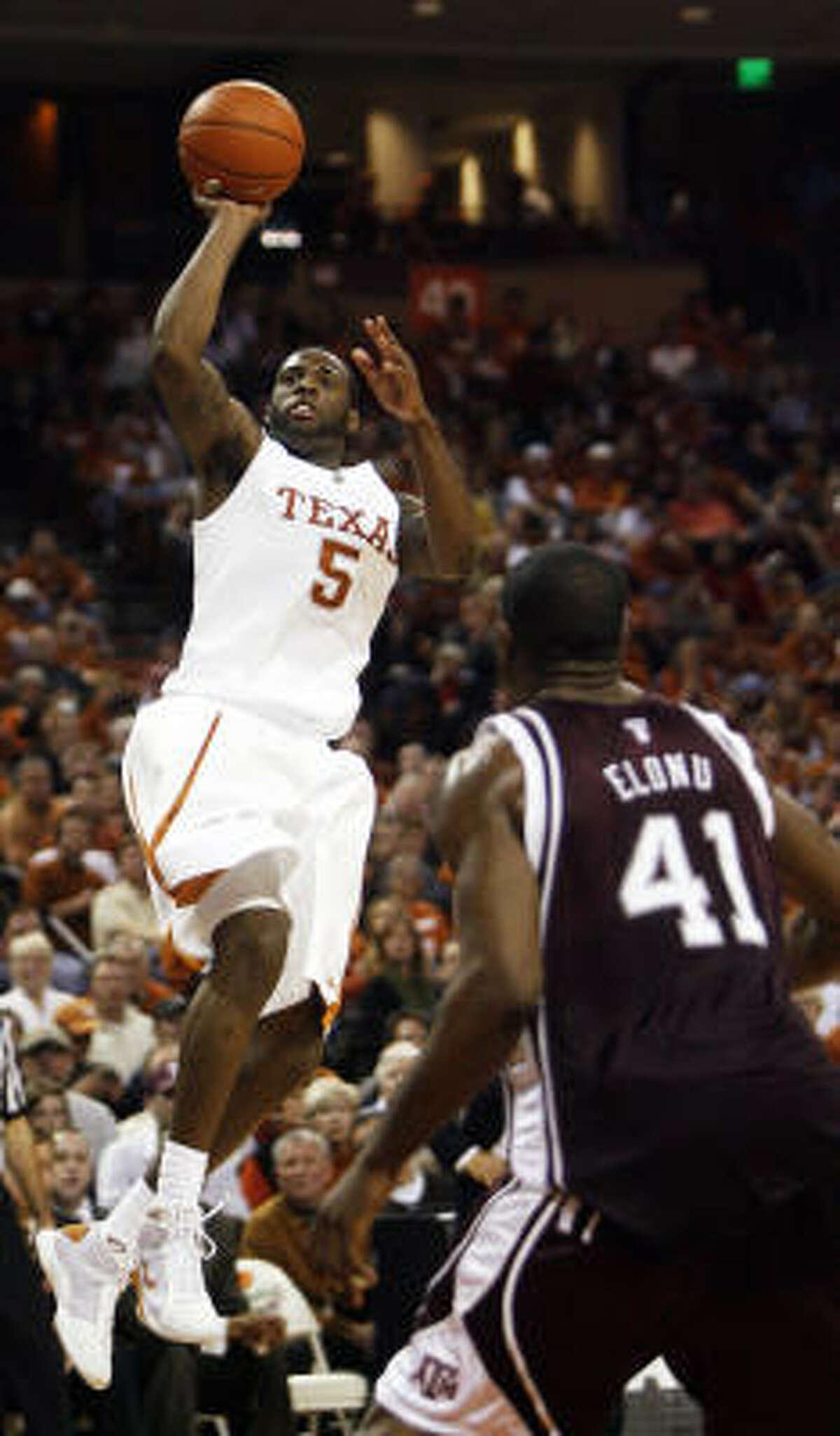 Texas' Damion James shoots during Texas' 19th consecutive home win.