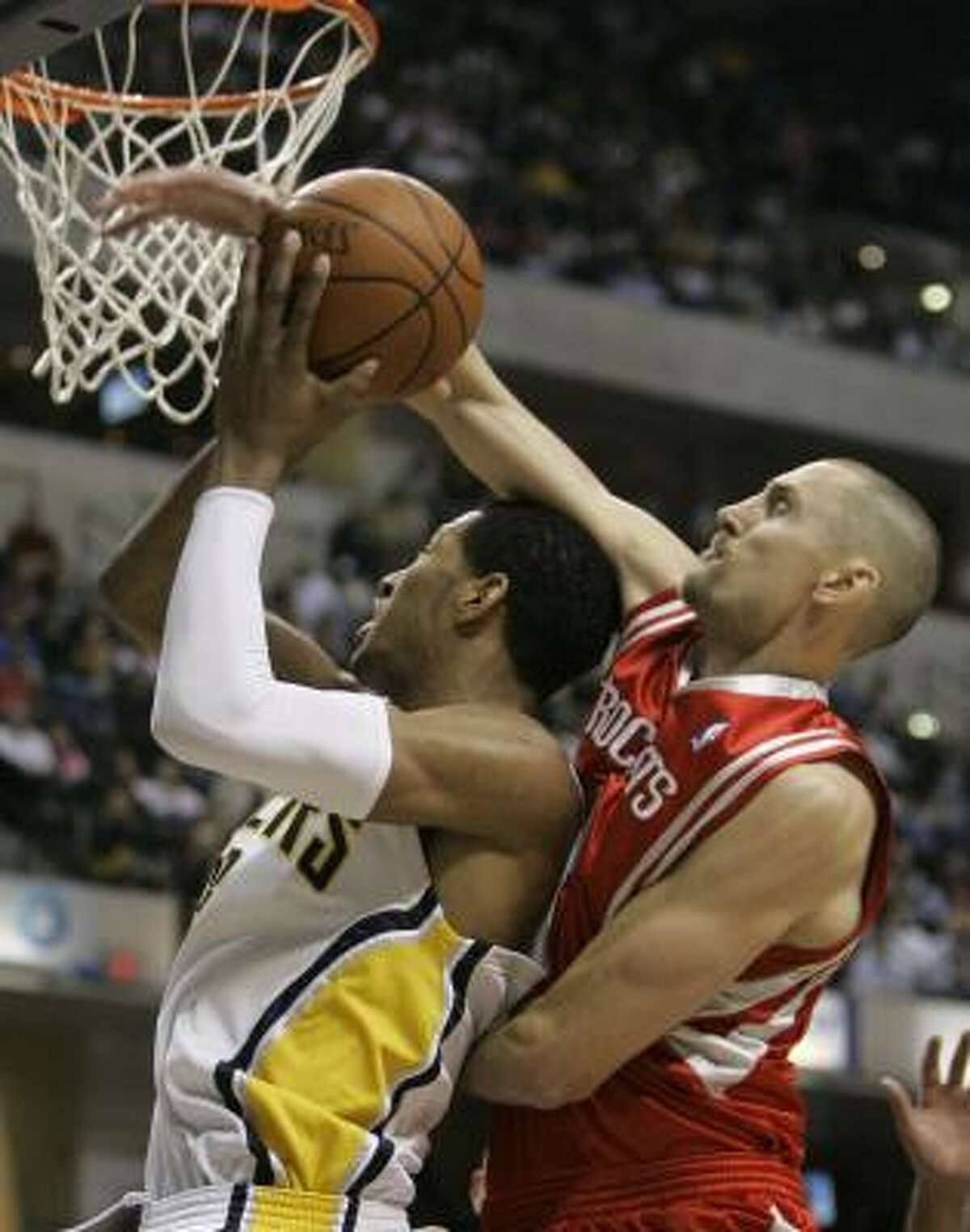 Pacers forward Danny Granger, left, has his shot blocked from behind by Brent Barry in the third quarter.