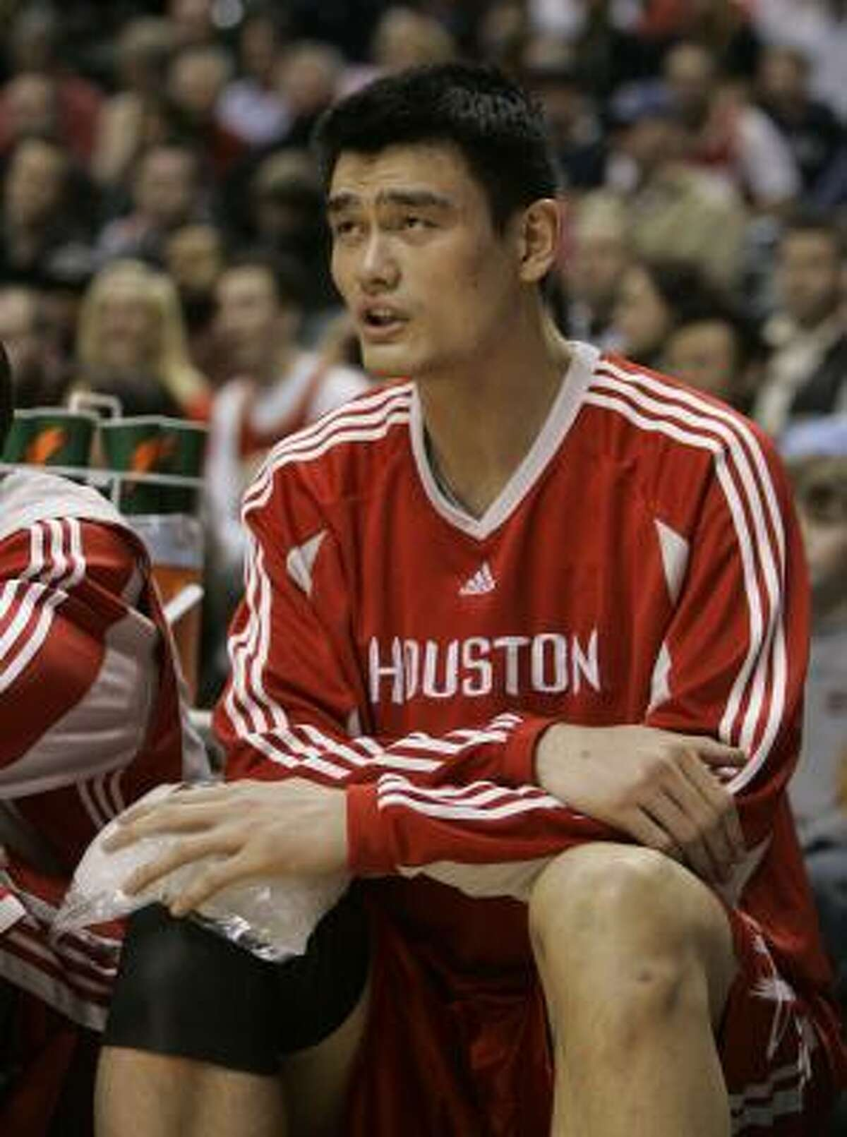Yao Ming holds an ice pack on his knee during the second quarter. He did not play in the second half.