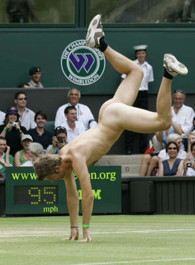 ** FOR USE WITH YEAR END--FILE **An unidentified streaker does a cartwheel, as he interrupts the Women's Singles quarter-final match between Maria Sharapova and Elena Dementieva, both of Russia,  on the Centre Court at Wimbledon, in this July 4, 2006, file photo. Photo: ANJA NIEDRINGHAUS, AP
