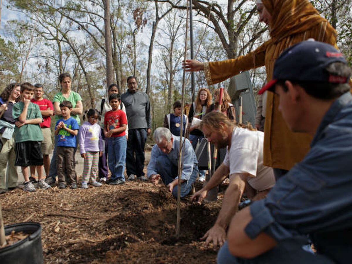 ARBORETUM'S ARBOR DAY: Visitors to the Houston Arboretum and Nature Center learn how to properly plant a tree at the 2009 Arbor Day Celebration.