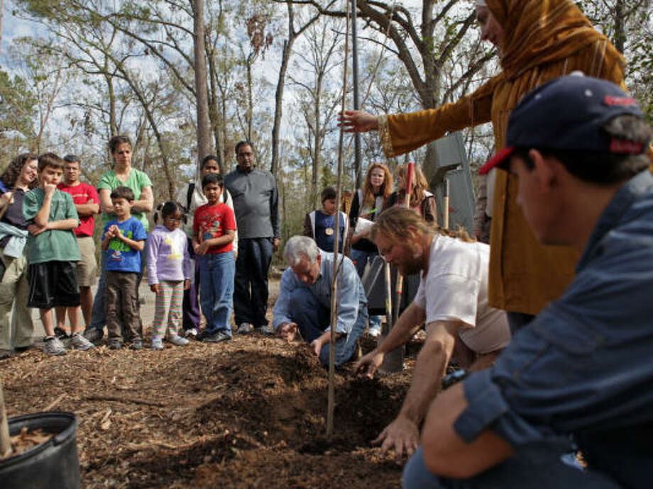 ARBORETUM'S ARBOR DAY:Visitors to the Houston Arboretum and Nature Center learn how to properly plant a tree at the 2009 Arbor Day Celebration. Photo: Jason Brown, For The Chronicle