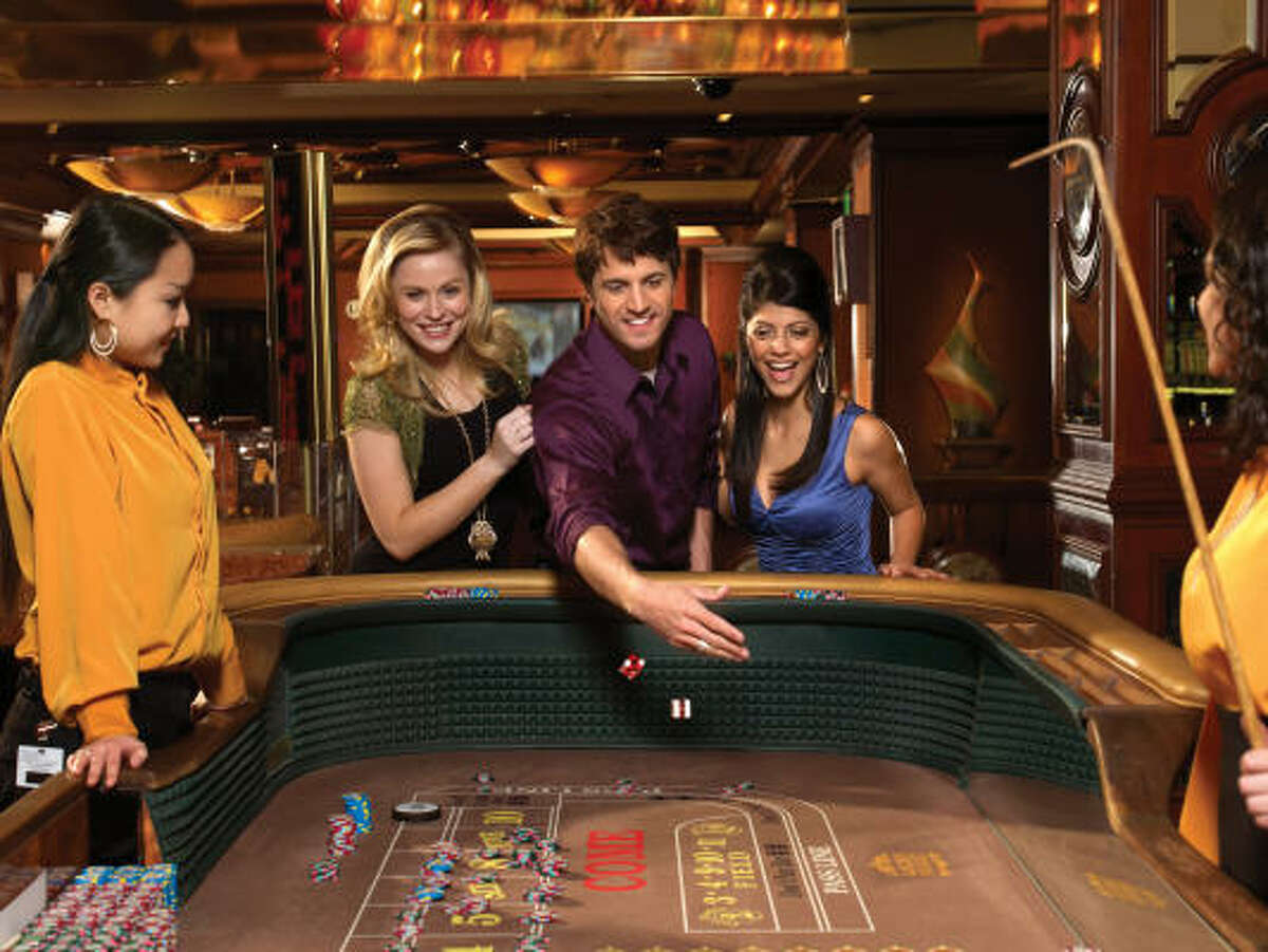 In craps, the shooter throws the dice to the other end of the table, hoping for a 7 or 11 on the first roll.