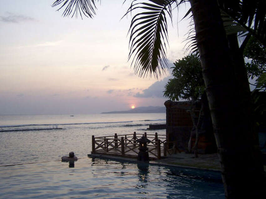A sunset in Candidasa, Bali, is a sight to savor.