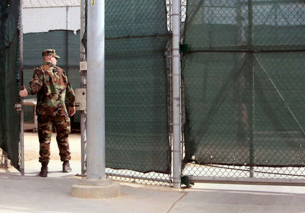 A guard walks through a gate at Guantanamo's Camp 6 detention center at the U.S. Naval Base Wednesday, Jan. 21.