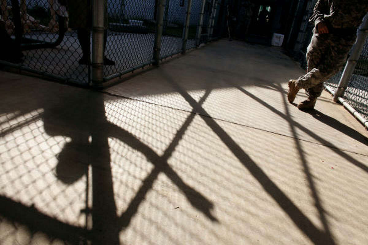 A guard stands in Guantanamo's Camp 5 detention center Wednesday, Jan. 21. The Guantanamo Bay war crimes court came to a halt at President Obama's request to suspend proceedings while he reviews former President Bush's policies.