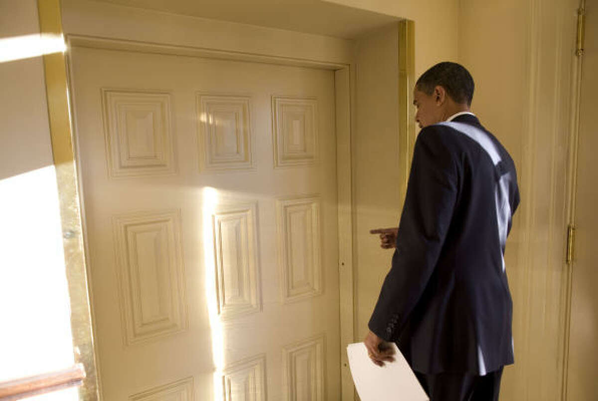 President Barack Obama prepares to walk into the Oval Office at the White House Wednesday morning.