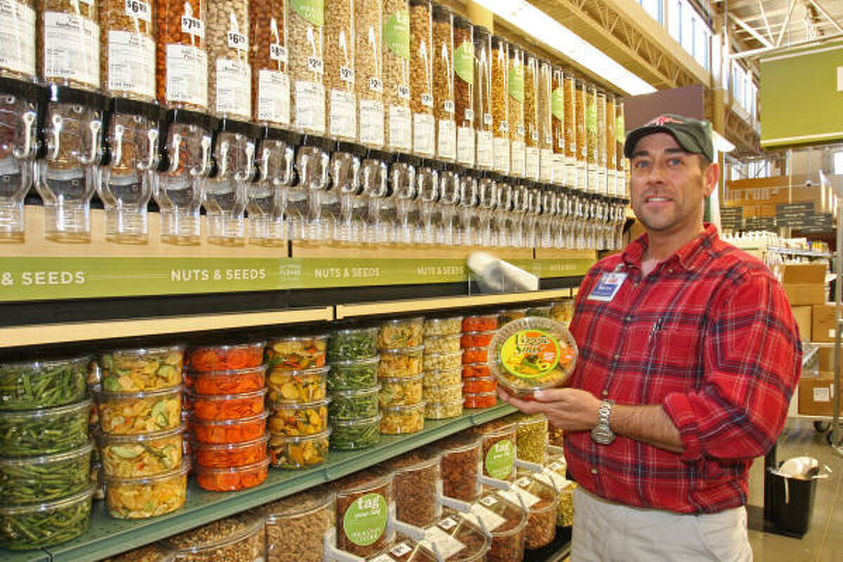 Triston Vannucci, healthy living manager, in the all-natural foods department where nuts and seeds are sold by the pound.