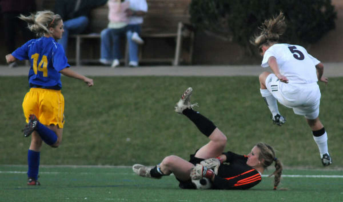 KLEIN VS. CINCO RANCHWho : Klein goalkeeper Kelly Roliard and Cinco Ranch's Jordan Hatler (5).