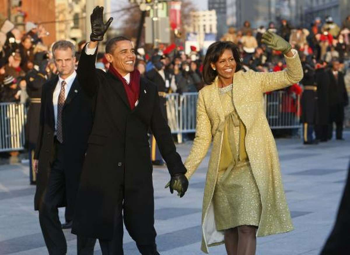 President Barack Obama and first lady Michelle Obama walk the inaugural parade route in Washington Tuesday.