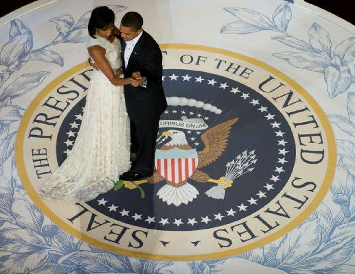President Barack Obama and first lady Michelle Obama dance during the Commander-in-Chief Ball at the National Building Museum in Washington.