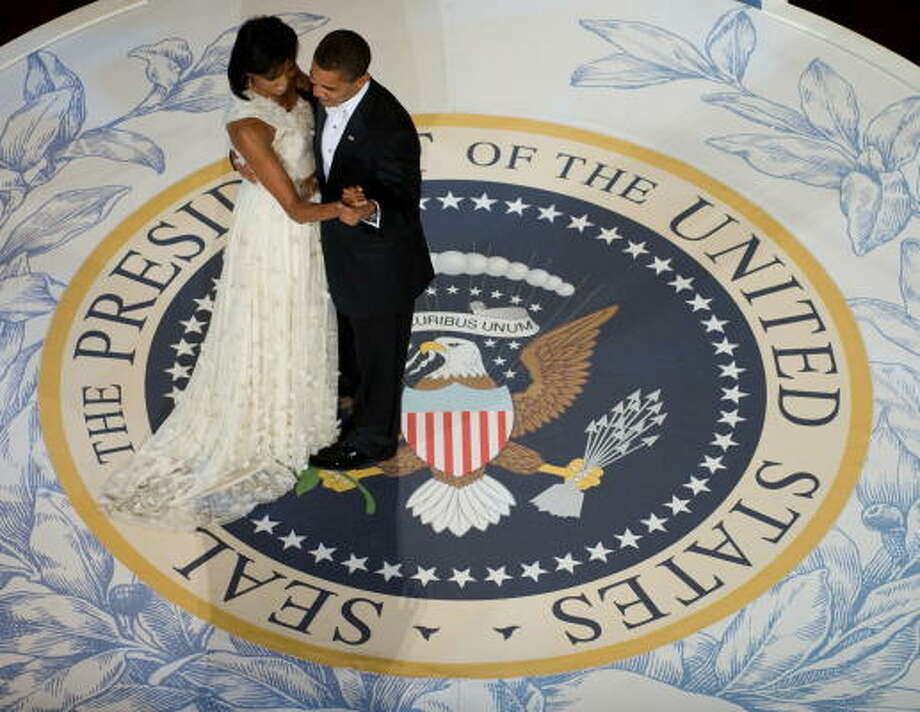 President Barack Obama and first lady Michelle Obama dance during the Commander-in-Chief Ball at the National Building Museum in Washington. Photo: SAUL LOEB, AFP/Getty Images