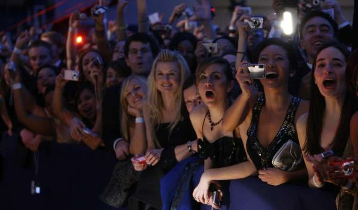 Supporters cheer President Barack Obama and first lady Michelle Obama at the Youth Inaugural Ball in Washington Tuesday.