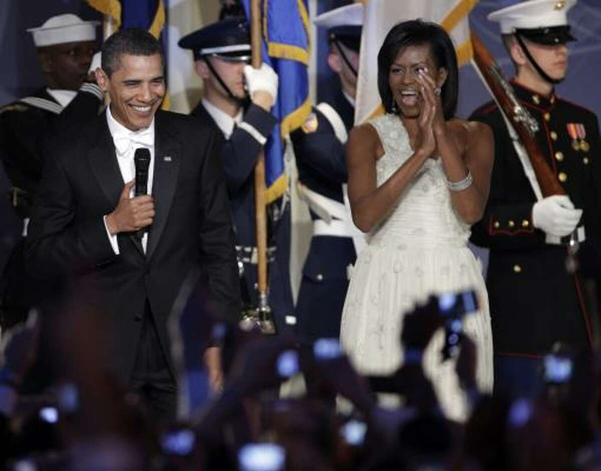 President Barack Obama and his wife Michelle Obama look to the crowd at the Youth Inaugural Ball at the Washington Hilton in Washington Tuesday.