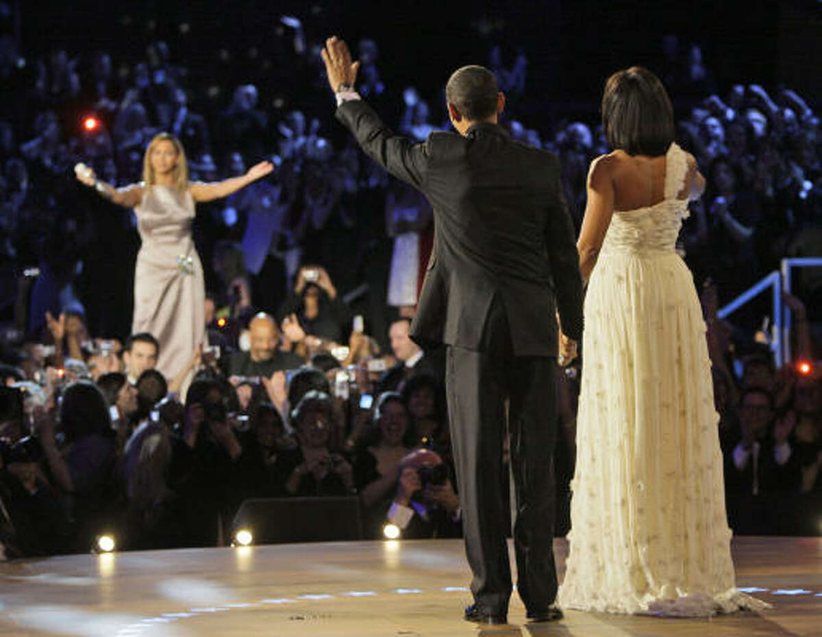 President Barack Obama and first lady Michelle Obama wave to Beyoncé sang At Last for their dance at the Neighborhood Inaugural Ball in Washington.