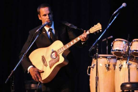 Singer Jack Johnson performs at the Obama Home States Inaugural Ball in Washington Tuesday.