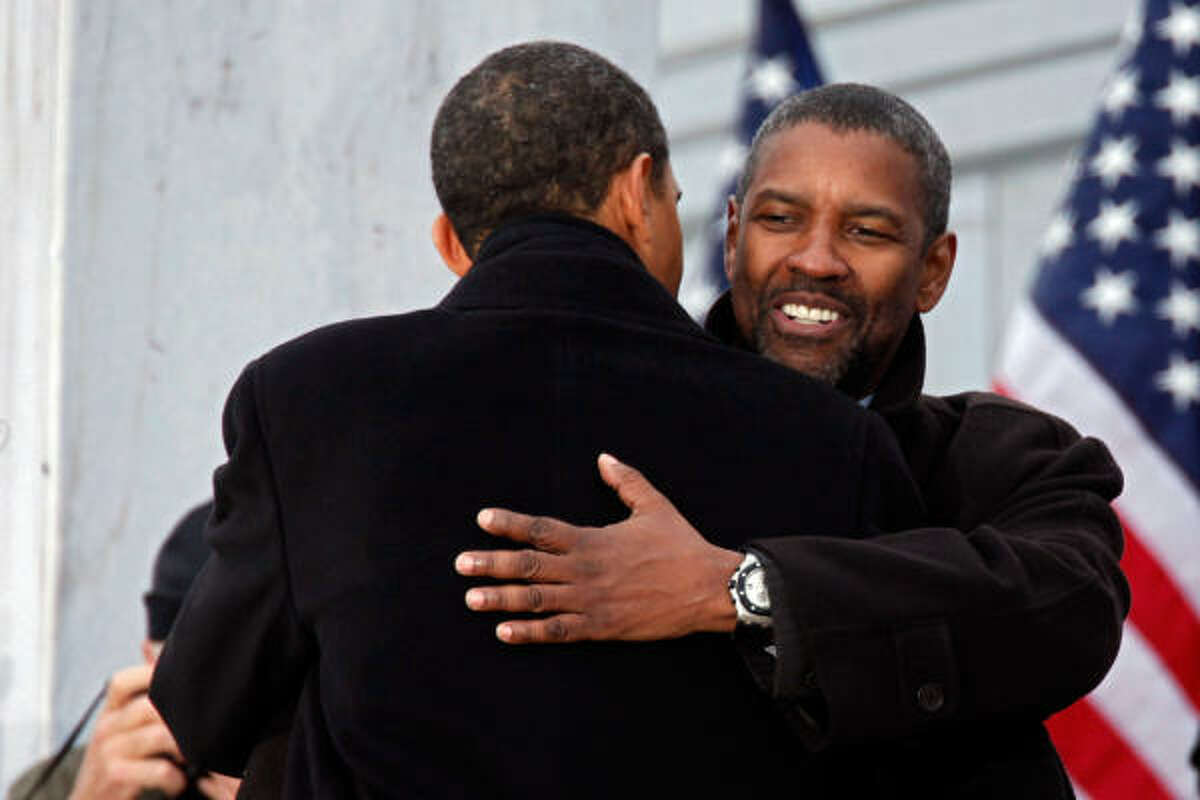 President-elect Barack Obama hugs actor Denzel Washington in front of the Lincoln Memorial during the