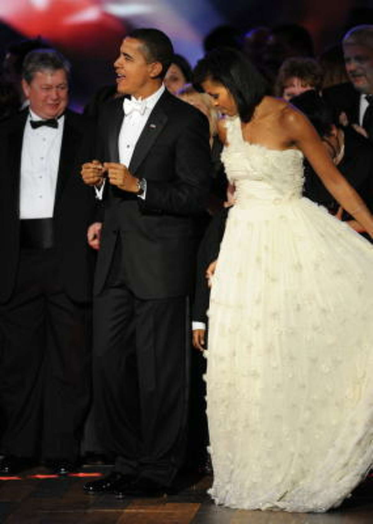 Michelle Obama chose a soft white, off-shoulder gown for the Neighborhood Ball Tuesday in Washington.