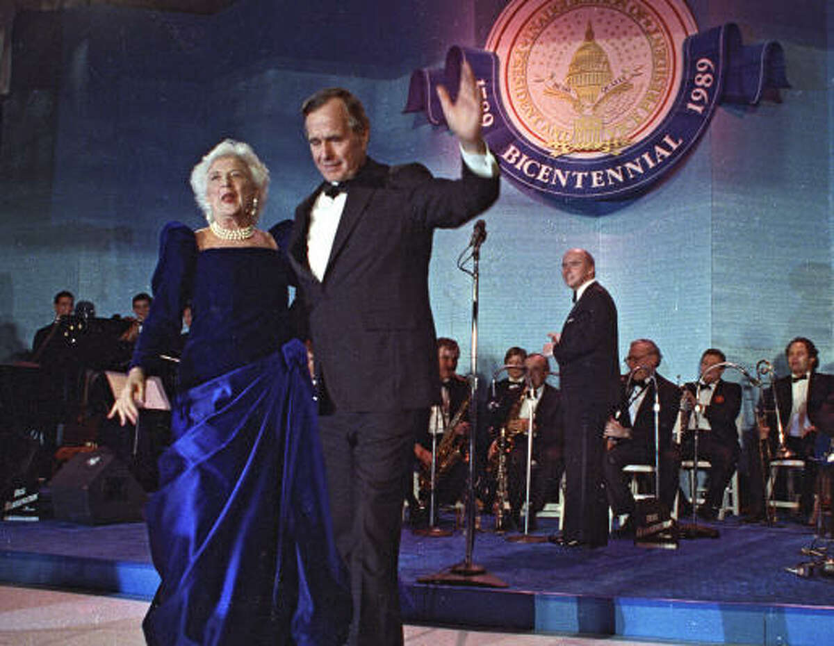 Barbara Bush had a reputation as a grandmotherly figure when her husband took office in 1989, but she proved that grandmothers can be fashionable in this royal blue gown with velvet bodice, square neck and diagonal dropped waist designed by Arnold Scaasi.