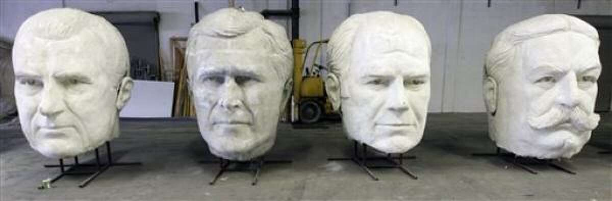 Statues of former and the current U.S. president, from left, to right, Richard Nixon, George W. Bush, Gerald Ford and William Howard Taft, are shown in sculptor David Adickes' studio in Houston.