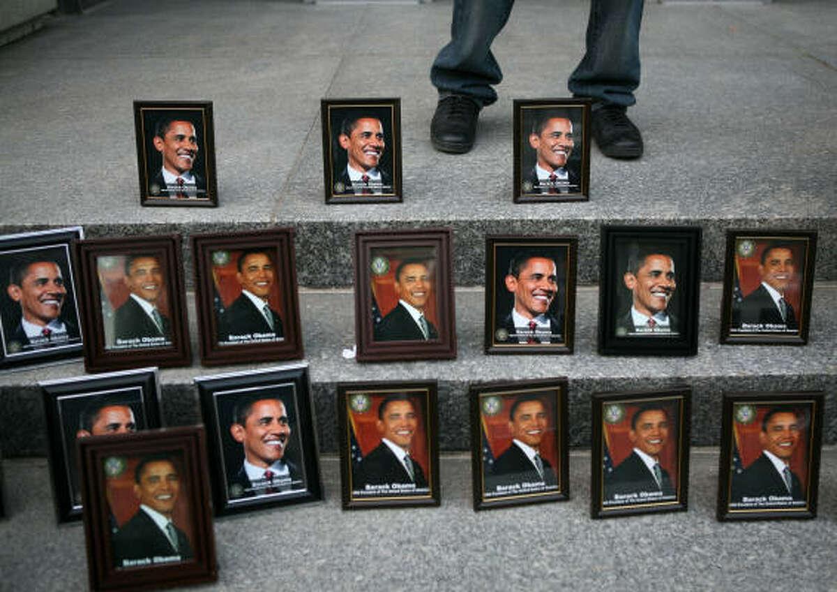 A street vendor sells framed photographs of Barack Obama Monday in Washington, D.C.