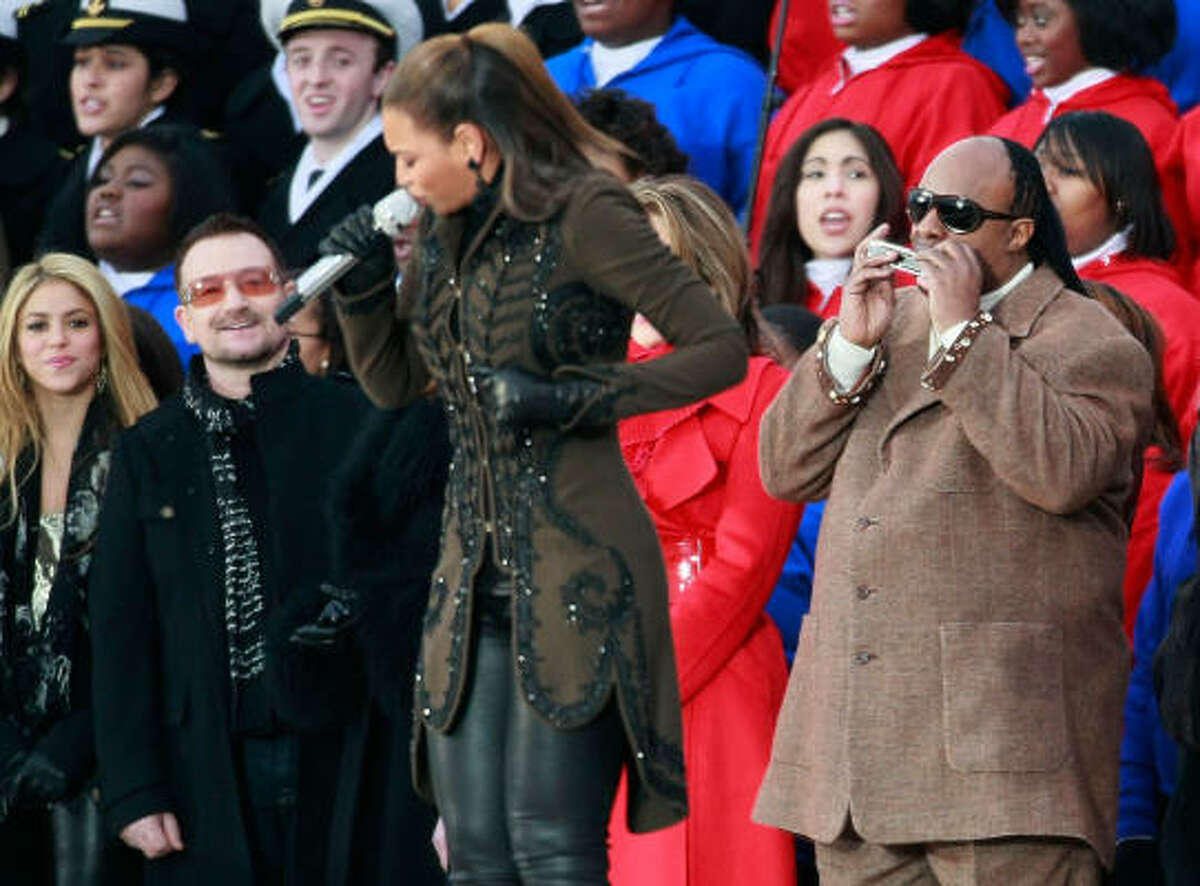 Beyoncé sings America the Beautiful at the end of Sunday's concert celebration and will serenade the new president and first lady at their first inaugural ball Tuesday night.